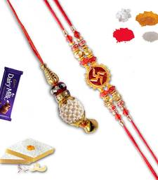 Buy Auspicious swastik and lumba rakhi set of bhaiya bhabhi with gm kaju katli bhaiya-bhabhi-rakhi online