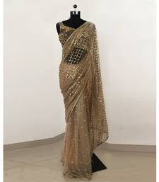 Beige sequin embroidered net saree With Blouse