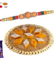 Buy Kesar kaju katli sweet with wooden bead rakhi rakhi-with-sweet online