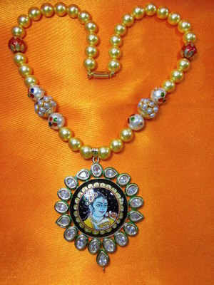 Tanjore paintings pendant, dancing Krishna pendant stringed with yellow barrels, Pachi beads and red roundels.