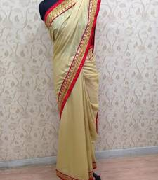 Buy laara dutta red beigh saree crepe-saree online
