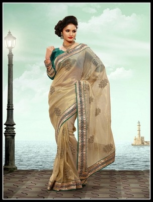 Unique Beige Embroidered Saree