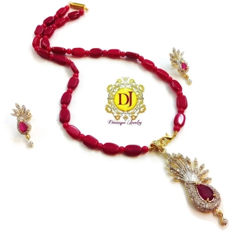 Ruby Peacock ad pendent set