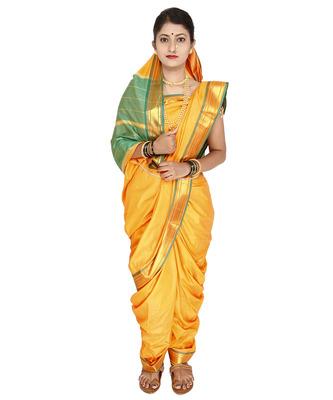 Yellow plain cotton silk nauvari saree