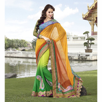 The Tawny and Green embroidered ladies Party wear saree based on Georgette and Jacquard Fabric.