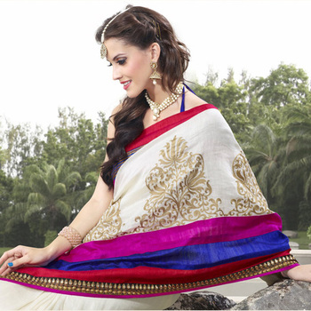The Off-white embroidered ladies Party wear saree based on Cotton Fabric.