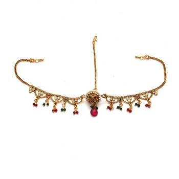 Anvi's maang tikka (bore set) studded with white stones, rubies and emeralds beads