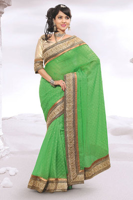 This a Green Zari and Patch-patti Worked Saree with Net Butti