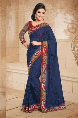 A Blue Net Saree Decorated With Zari Resham Embroidery and Patch work