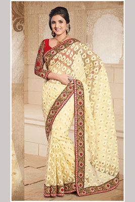 A Yellow Zari and Resham Embroidery work Tissue Brasso Saree
