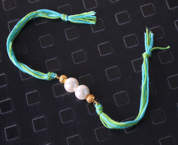 Turquoise And Green Pearl Rakhi