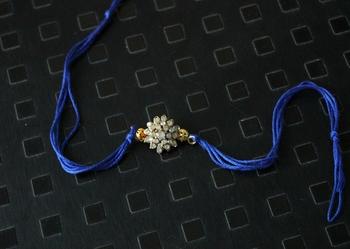 Zirconia Flower Blue Rakhi