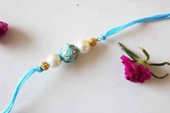 Turquoise Meenakari Kundan Work And Pearl Rakhi