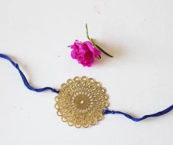 Blue And Gold Filigree Flower Rakhi