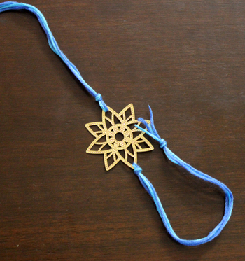 Blue And Gold Filigree Star Rakhi
