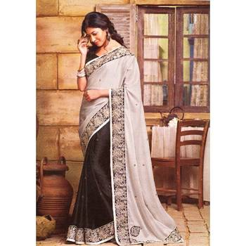 Cream and black half and half saree with intricate border