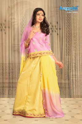 Yellow And Pink Shaded Rajasthani Poshak Showing Butta Work And Lace Border Work