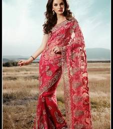 Attractive red & salmon embroidered saree
