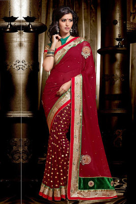 This a Maroon Georgette Saree Decked with Georgette Saree