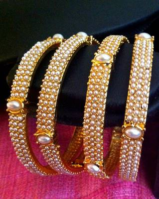 Pair of 4 bangles,golden finish very ethnic with glowing pearl bangles rj27