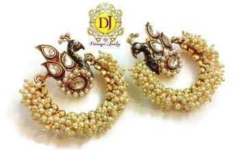 Blissful peacock earrings , pearl