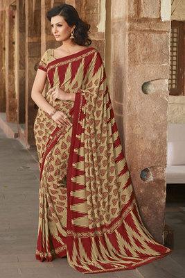 This a Cream and Maroon Art Silk Printed Saree