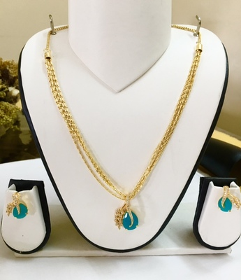 Gold and Light blue Pendant set