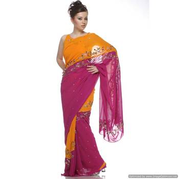 A Two Sided Yellow And Magenta , Viscous Georgette Sari With Crystals , And Sequins