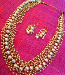 Buy Array of small pearls with a single strand of bold pearls mala necklace set Necklace online