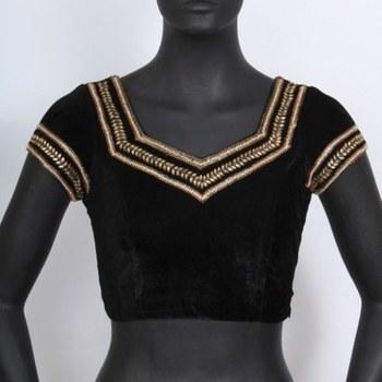 A royal velvet blouse with kundan work.