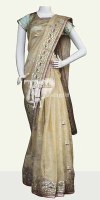 Sizzling cream supernet cotton designer border saree