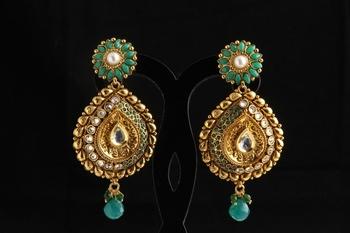 Designer ethnic polki,pearl and semiprecious studded jhumka