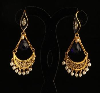 Moon shaped jaali with pearl drop designer earrings
