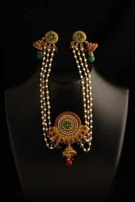 Designer earrings with multistrand pearl and turquoise pendant attached