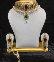 Buy Close Neck Style Kundan Jewelry in Red with Green and Pearls hot-deal online