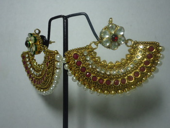 Rajwadi  earrings with kundan and maroon stones.