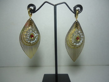 Delicate Gold Filigree leaf with kundan and stones.