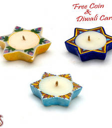 Buy Multicolor star shape wax filled candle diyas- set of 4 candle online