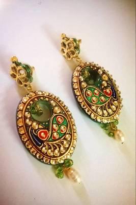 elegant tnjore art peacock earring