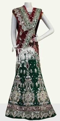 Gorgeous green pitazari diamond work velvet wedding lehenga