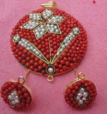 Red and white Takkar work pendent with earrings
