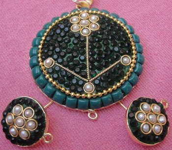Green black takkar work pendent with earrings