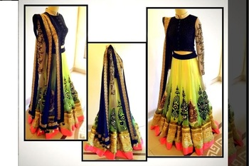 yellow embrodered net designeer lehngha choli with blouse