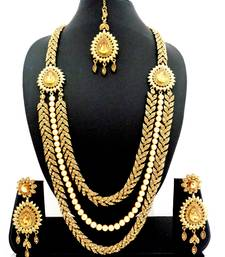 Buy Three liner golden stone long bridal necklace set with maang tikka bridal-set online