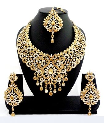 Designer golden white stone bridal necklace set with maang tikka