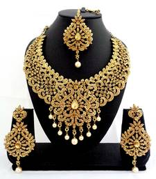 Buy Designer golden stone bridal necklace set with maang tikka bridal-set online