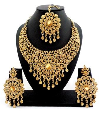 Designer golden stone bridal necklace set with maang tikka