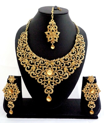 Designer golden stone bridal necklace set with maang tikka
