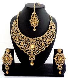 Buy Designer golden stone bridal necklace set with maang tikka necklace-set online