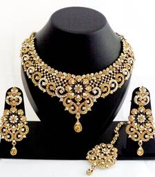 Designer golden white stone wedding necklace set with maang tikka